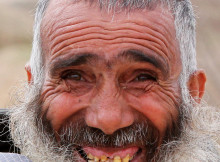 Afghan man smiles for a photo